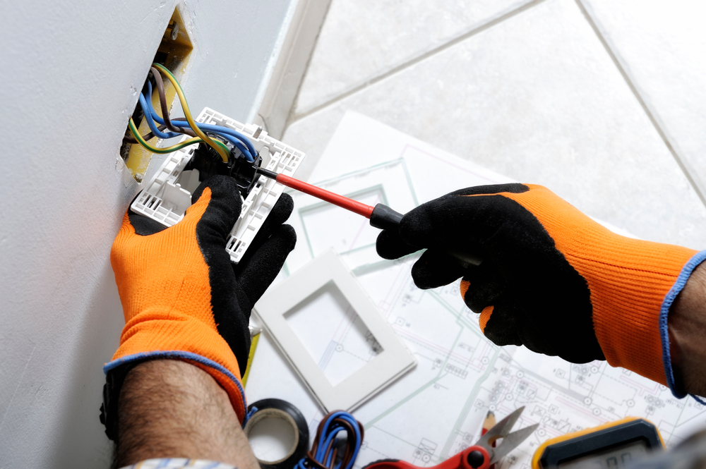 Electrician,working,safely,on,switches,and,sockets,of,a,residential