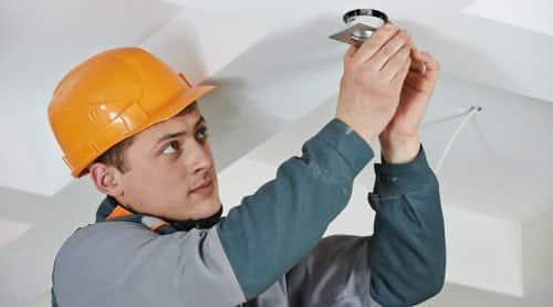 Electrician at spot light installation