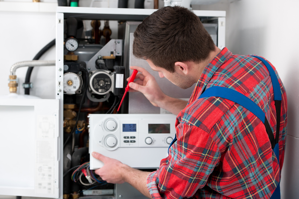 Technician,servicing,the,gas,boiler,for,hot,water,and,heating